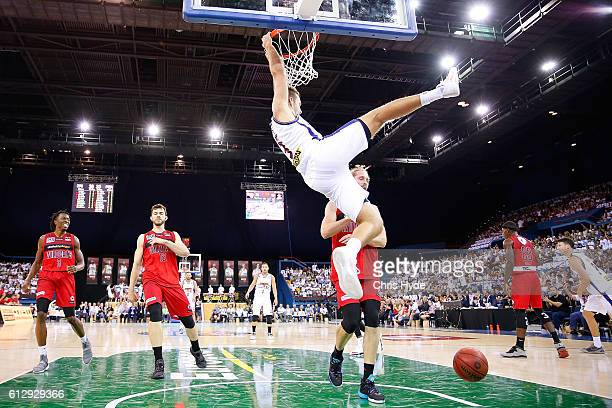 Mitchell Young of th Bullets dunks during the round one NBL match between the Brisbane Bullets and the Perth Wildcats at the Brisbane Entertainment...