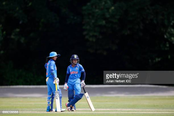 Mithali Raj and Punam Raut of India confer between overs during The ICC Women's World Cup warm up match between India and Sri Lanka at Queens Park on...