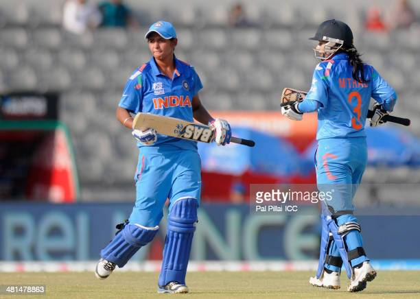 Mithali Raj captain of India and Jarmanpreet Bhullar of India run between the wickets during the ICC Women's World Twenty20 match between Bangladesh...