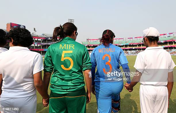 Mithali Raj Captain of India and Sana Mir Captain of Pakistan lead their teams out during the Women's ICC World Twenty20 India 2016 match between...