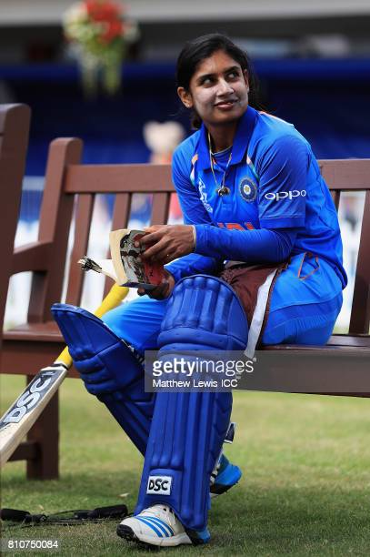 Mithali Raj captain of India reads a book ahead of her batting innings during the ICC Women's World Cup 2017 match between South Africa and India at...