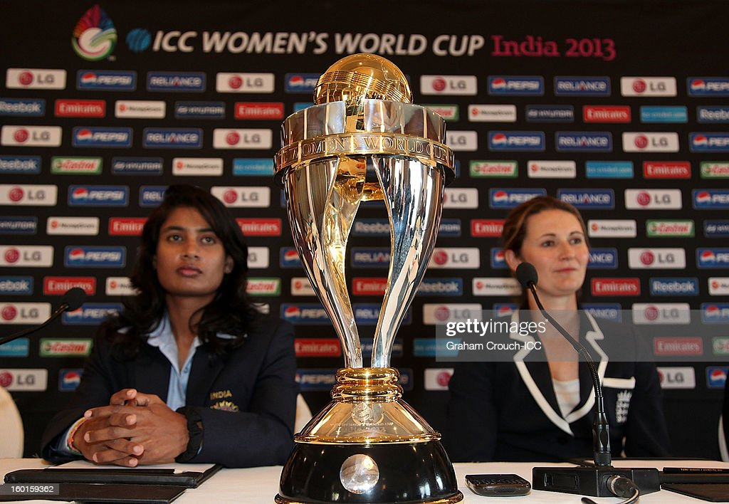 Mithali Raj of India and <a gi-track='captionPersonalityLinkClicked' href=/galleries/search?phrase=Charlotte+Edwards&family=editorial&specificpeople=618915 ng-click='$event.stopPropagation()'>Charlotte Edwards</a> of England with the ICC Womens World Cup trophy attend the Captains Group A Press Conference at the Taj Mahal Palace Hotel on January 27, 2013 in Mumbai, India.