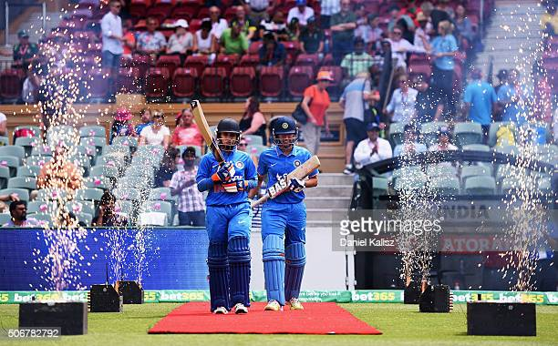 Mithali Raj of India and Smriti Mandhana of India walk out to bat during the women's Twenty20 International match between Australia and India at...