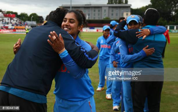 Mithali Raj of India and team mates celebrate making it to the semi final during the ICC Women's World Cup match between India and New Zealand at The...