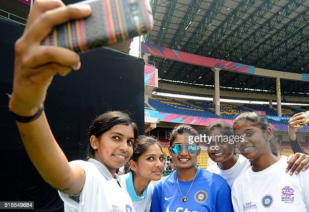 Mithali Raj of India poses for a selfie for the local kids during an Women's ICC World Twenty20 India 2016 Team Swachh cricket clinic in partnership...