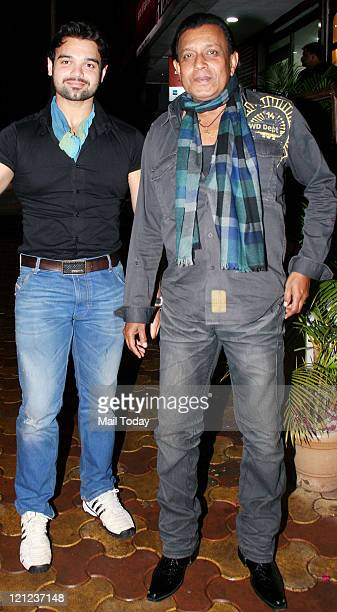 Mithun Chakraborty with his son Mimoh Chakraborty during Padmini Kolhapure's 25th wedding anniversary at Balthazar in Juhu Mumbai on August142011