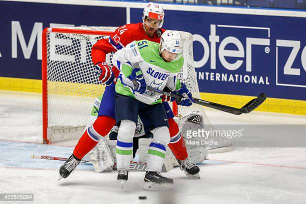 Mitja Robar of Slovenia and Andreas Martinsen of Norway battle for the puck during the IIHF World Championship group B match between Slovenia and...