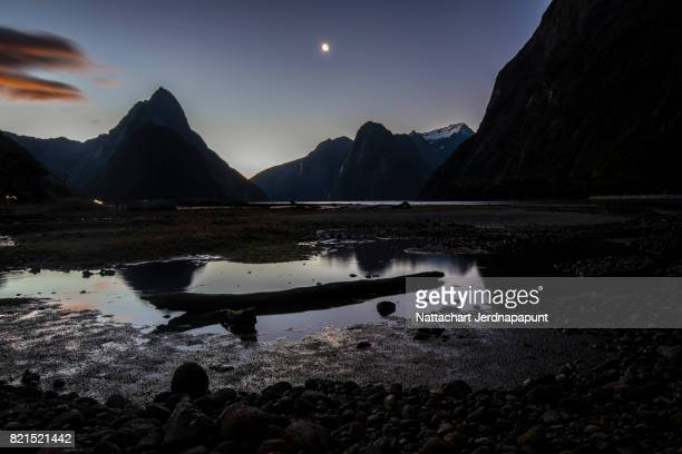 Mitre Peak with nice shape green rock at dawn in Milford sound, New Zealand