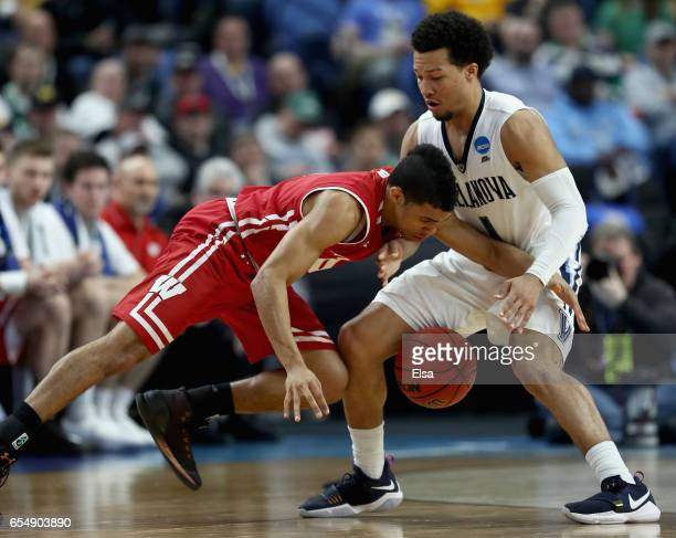 Mitrik Trice of the Wisconsin Badgers and Jalen Brunson of the Villanova Wildcats battle for a loose ball during the second round of the 2017 NCAA...