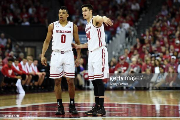 Mitrik Trice speaks with Bronson Koenig of the Wisconsin Badgers at midcourt during the first half of a game against the Maryland Terrapins at the...