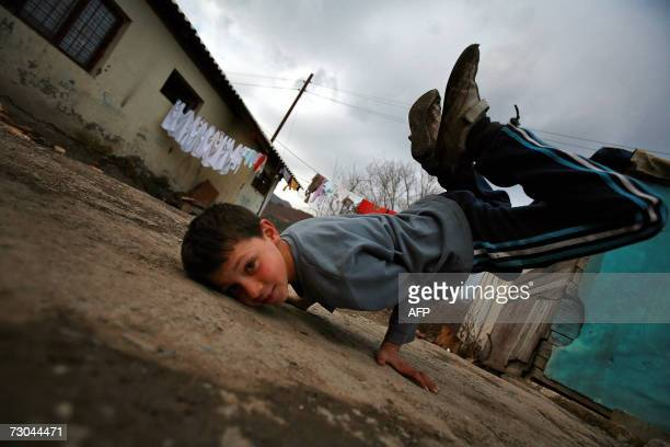A Roma boy practices breakdance in the Zitkovac refugee camp in North Mitrovica 19 January 2007 40 families and 100 children live there near toxic...