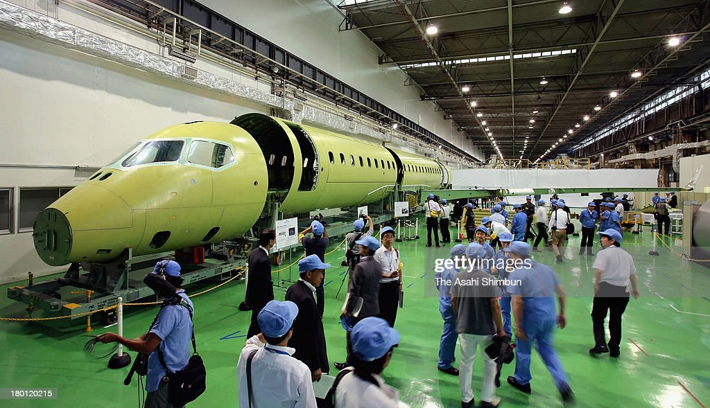 Mitsubishi Aircraft Corp. shows a partly assembled Mitsubishi Regional Jet, Japanfs first domestically produced small passenger jet, to reporters for the first time on September 7, 2013 in Tobishima, Aichi, Japan.