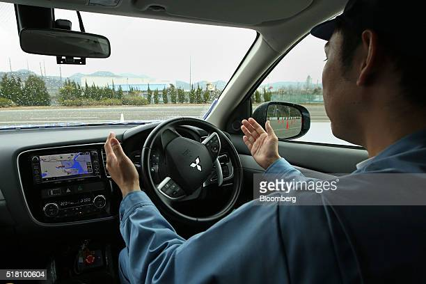 Mitsubishi Electric Corp employee demonstrates the company's selfdriving vehicle in Ako Hyogo Prefecture Japan on Friday March 18 2016 Mitsubishi...