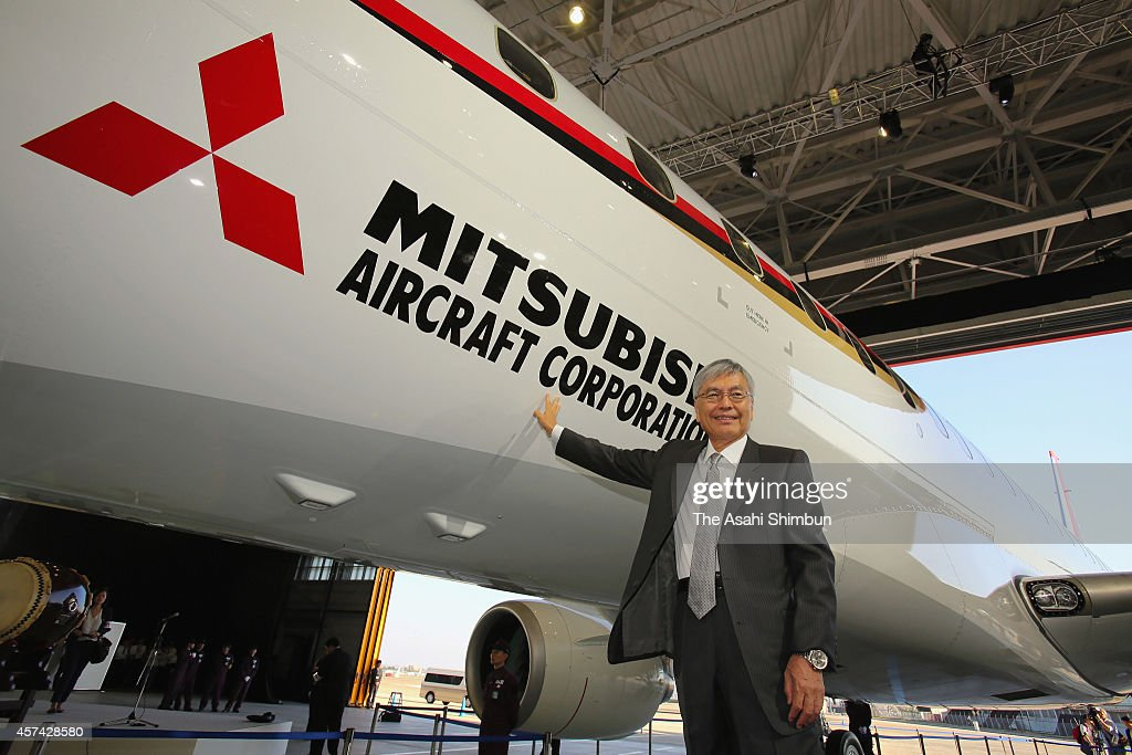 Mitsubishi Heavy Industries Chairman <a gi-track='captionPersonalityLinkClicked' href=/galleries/search?phrase=Hideaki+Omiya&family=editorial&specificpeople=5398116 ng-click='$event.stopPropagation()'>Hideaki Omiya</a> poses for photographs with the Mitsubishi Regional Jet (MRJ) passenger aircraft developed by Mitsubishi Aircraft Corp, during the rollout ceremony at Mitsubishi Heavy Industries Nagoya Aerospace Systems Works Komaki South Plant on October 18, 2014 in Toyoyama, Aichi, Japan. The 'made in Japan' jetliner is a highly fuel-efficient and quiet regional jet that can be used in smaller local airports. It will be the second modern Japanese airliner to enter service since Nihon Aircraft Manufacturing Corp.'s YS-11 in 1965.