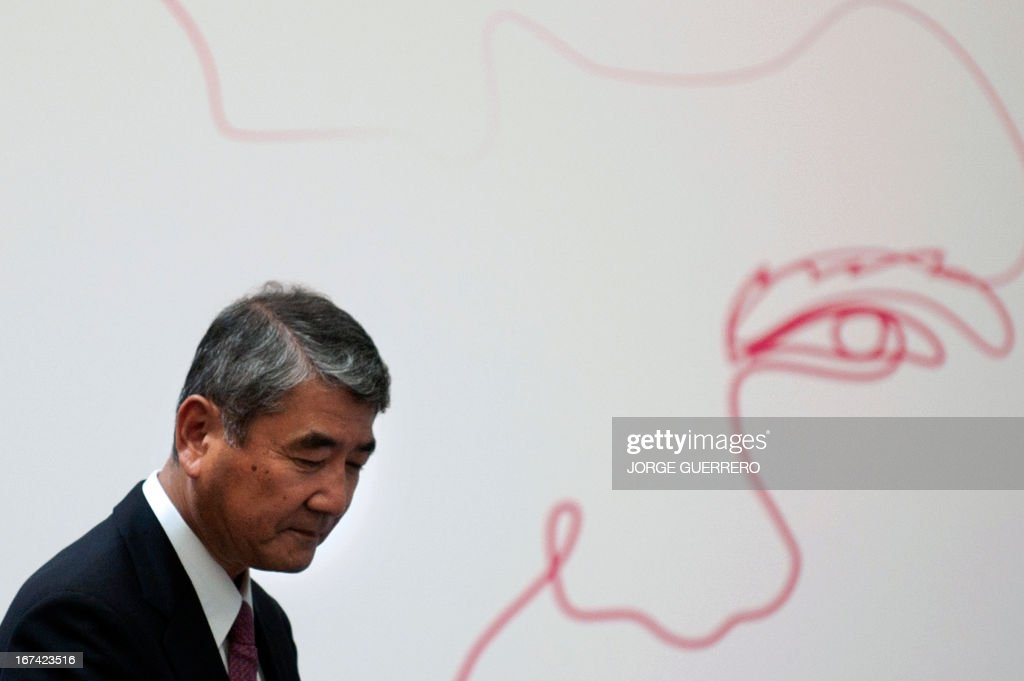 Mitsubishi Heavy Industries' Executive Vice President Akira Hishikawa looks on during the inauguration of the project 'Zem2All' at the Automobile museum in Malaga on April 25, 2013. Zem2All is a pilot project, carried out alongside the Japanese government, designed to estimate usage by drivers of electric vehicles in Malaga and provide an in-depth study of the impact of these vehicles.
