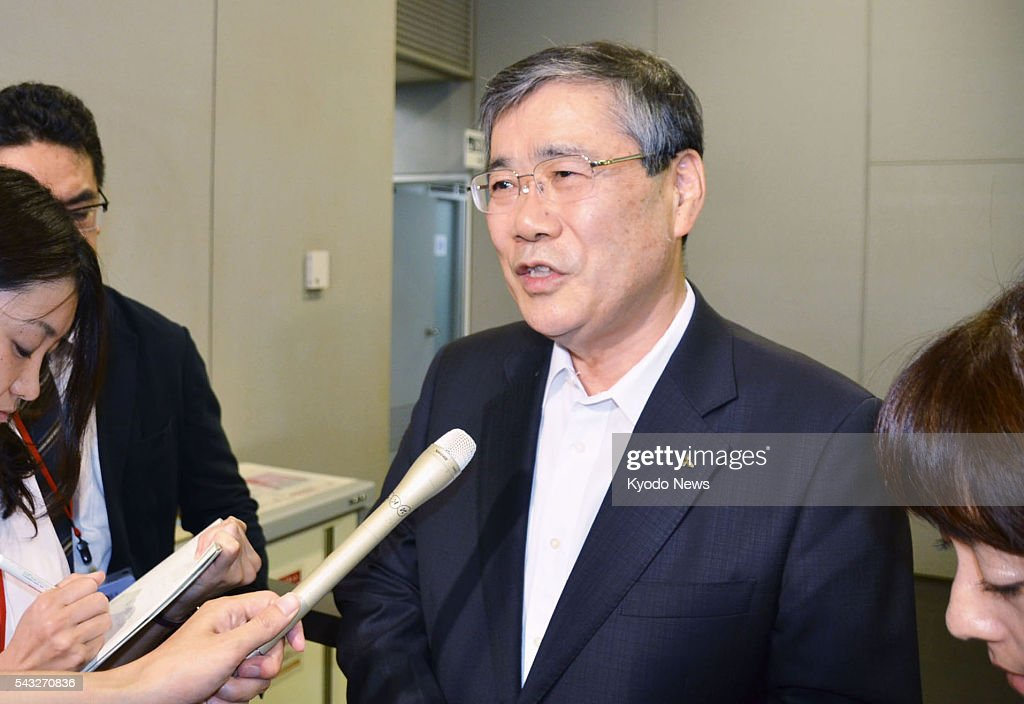 Mitsubishi Heavy Industries Ltd President Shunichi Miyanaga speaks to reporters in Tokyo on June 27 after attending a meeting between the Japanese...