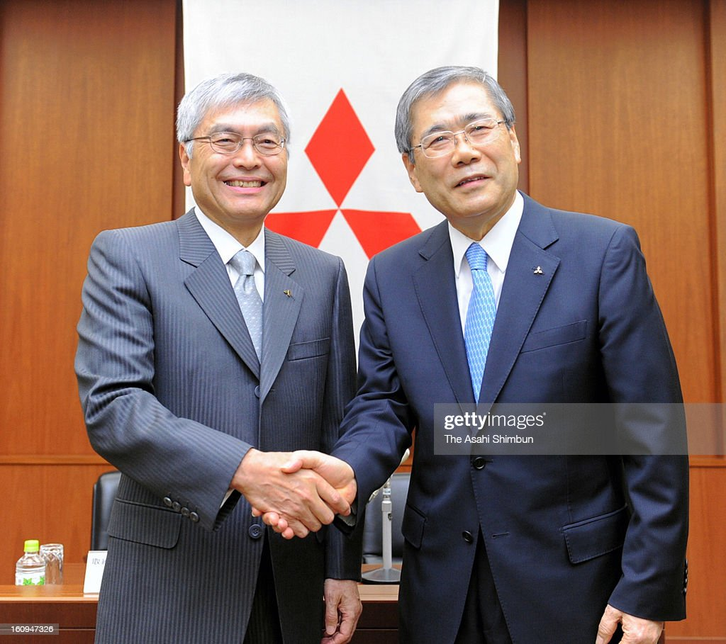 Mitsubishi Heavy Industries Representative Director and Senior Executive Vice President President Shunichi Miyanaga (R) shakes hands with President and CEO Hideaki Omiya (L) during a press conference announcing Miyanaga named the company's new President on February 6, 2013 in Tokyo, Japan.