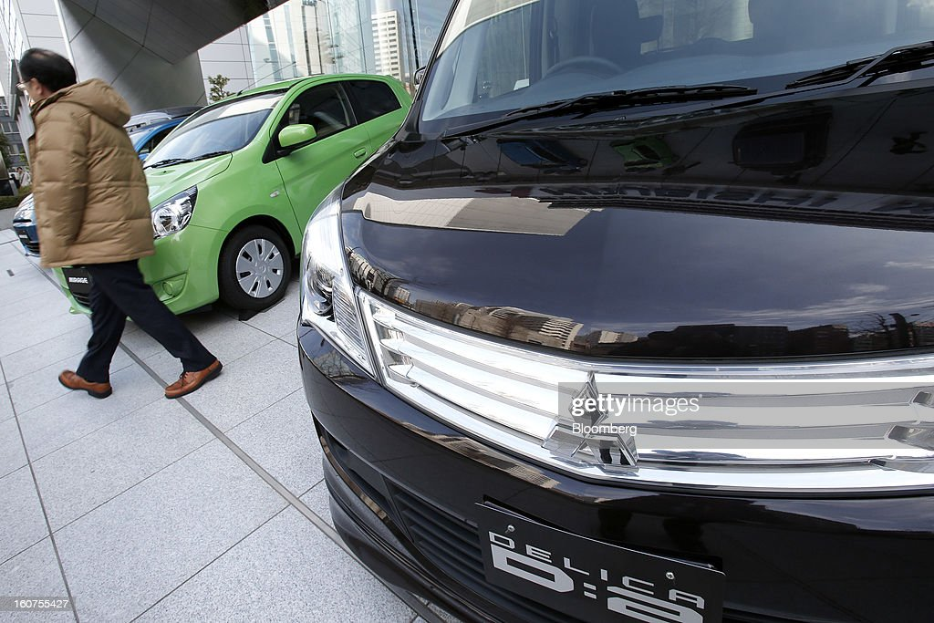 A Mitsubishi Motors Corp. Delica D2 compact minivan, right, is displayed outside the company's headquarters in Tokyo, Japan, on Tuesday, Feb. 5, 2013. Shares in Mitsubishi Motors dropped after the company reduced its operating profit forecast. Photographer: Kiyoshi Ota/Bloomberg via Getty Images