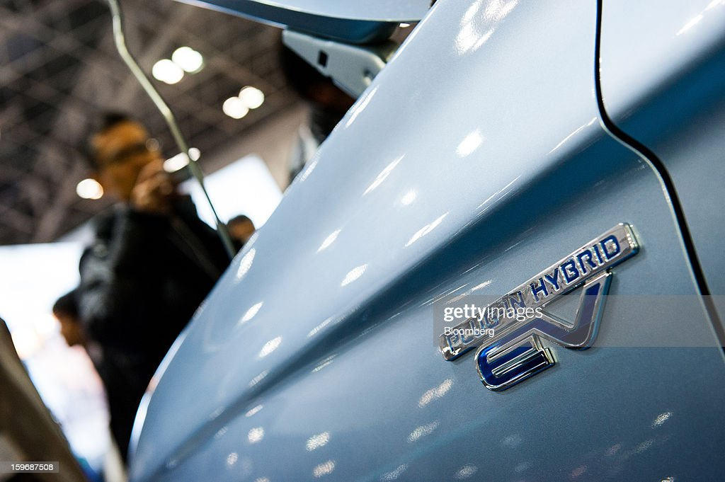 A Mitsubishi Motors Corp. Outlander PHEV vehicle is displayed at Automotive World 2013 in Tokyo, Japan, on Friday, Jan. 18, 2013. The Automotive World 2013 trade show ends today. Photographer: Noriko Hayashi/Bloomberg via Getty Images