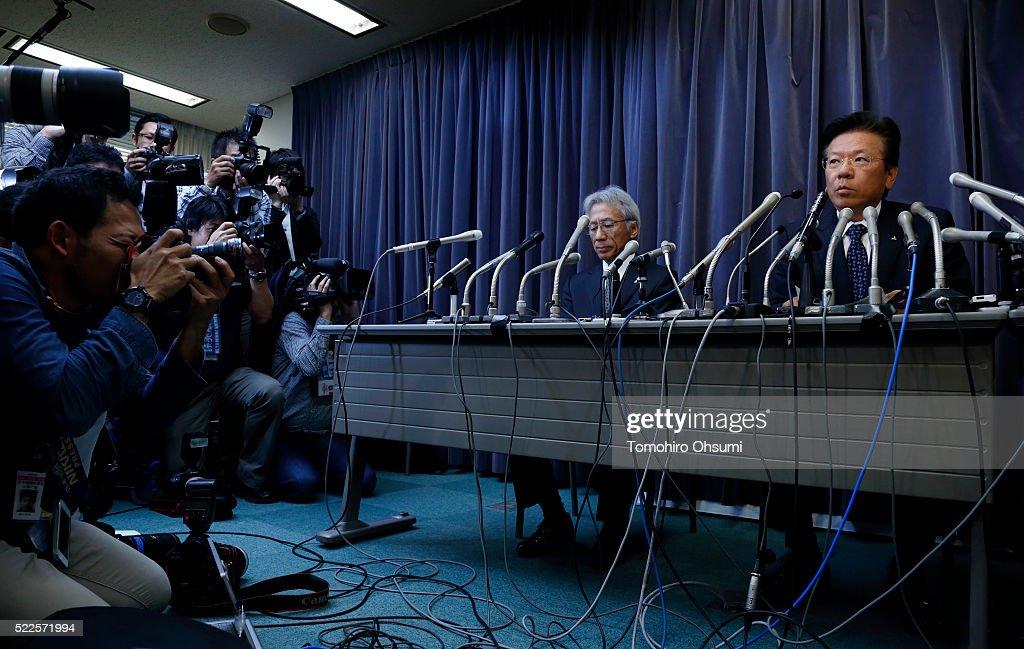 Mitsubishi Motors President Tetsuro Aikawa right speaks during a press conference on April 20 2016 in Tokyo Japan Mitsubishi Motors share plunged...