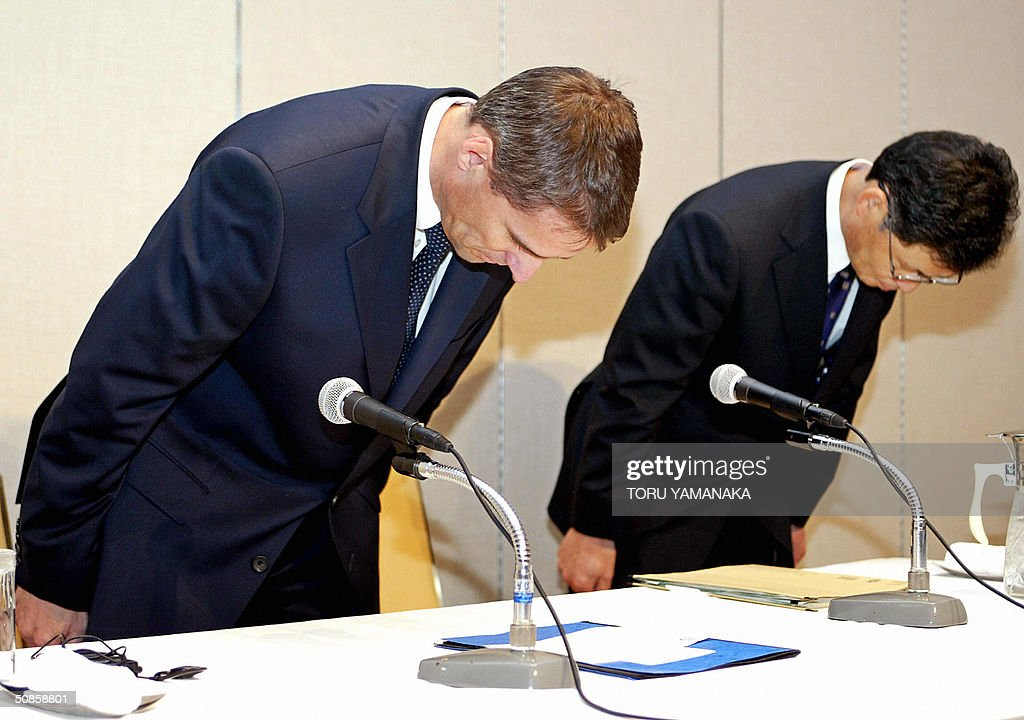 Mitsubishi Motors' truck-making affiliate Mitsubishi Fuso Truck and Bus President Wilfried Porth (L) and the company's quality and technical affairs officer Hideyuki Shiozawa (R) bow their heads as they announced another vehicle recall at a press conference in Tokyo 20 May 2004. Mitsubishi Fuso Truck and Bus, already reeling from a scandal over the suspected cover-up of a deadly wheel defect, said the recall involved four cases of defective trucks and buses, one of which appeared to have caused a fatal accident in western Japan in 2002. AFP PHOTO/Toru YAMANAKA
