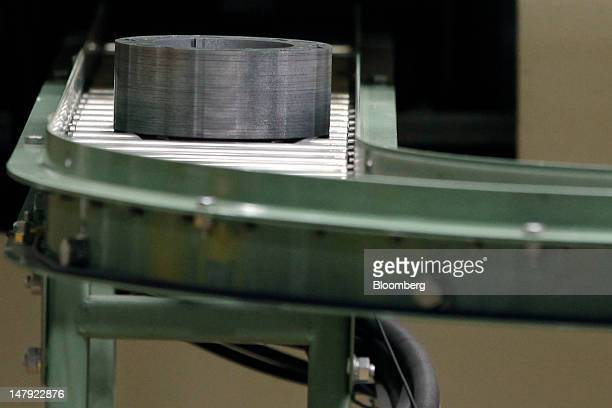 A Mitsui Hightec Inc motor core used for Toyota Motor Corp's hybrid vehicles moves along the production line of the company's plant in Kitakyushu...