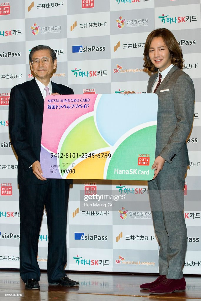 Mitsui Sumitomo Card Company, Ltd President Hideo Shimada and actor Jang Keun-Suk pose for media the promotional event of 'Mitsui Sumitomo Card' Korea Travel Prepaid at Lotte Hotel on November 13, 2012 in Seoul, South Korea.