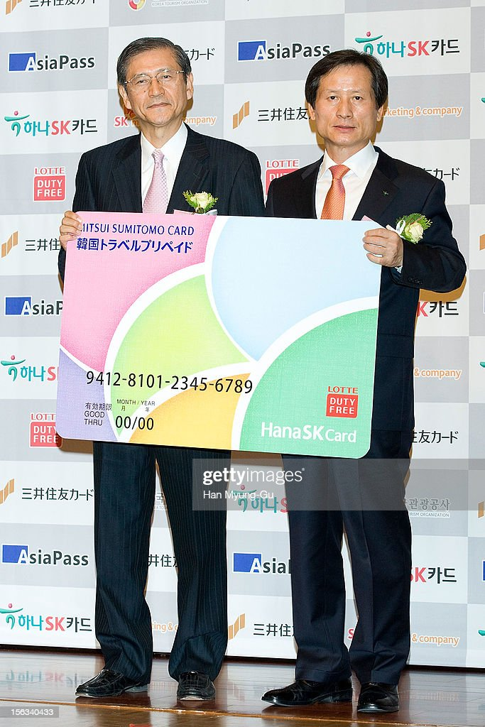 Mitsui Sumitomo Card Company, Ltd President Hideo Shimada and Hana SK Card, CEO Jeong Hae-Boong pose for media the promotional event of 'Mitsui Sumitomo Card' Korea Travel Prepaid at Lotte Hotel on November 13, 2012 in Seoul, South Korea.