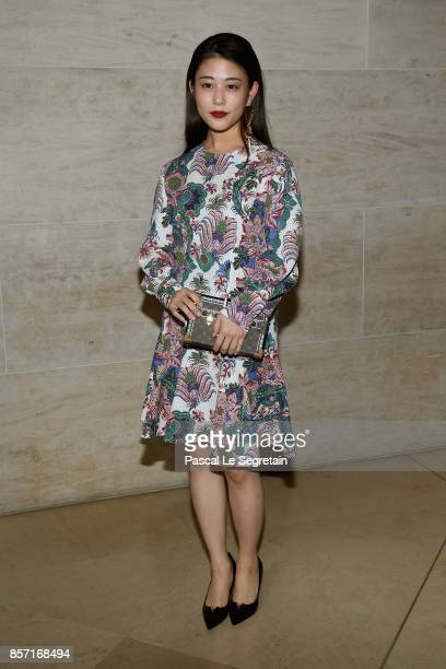 Mitsuki Takahata attends the Louis Vuitton show as part of the Paris Fashion Week Womenswear Spring/Summer 2018 on October 3 2017 in Paris France