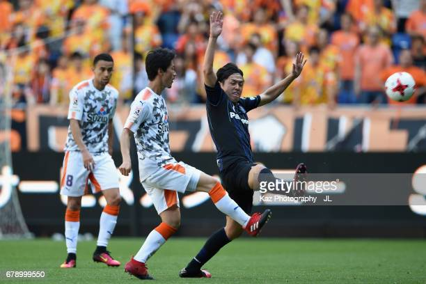 Mitsunari Musaka of Shimizu SPulse and Yasuhito Endo of Gamba Osaka compete for the ball during the JLeague J1 match between Gamba Osaka and Shimizu...
