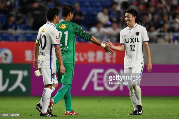 Mitsuo Ogasawara Hitoshi Sogahata and Daigo Nishi of Kashima Antlers celebrate their 10 victory in the JLeague J1 match between Gamba Osaka and...