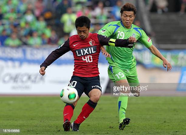 Mitsuo Ogasawara of Kashima Antlers and Shuhei Otsuki of Shonan Bellmare compete for the ball during the JLeague match between Shonan Bellmare and...