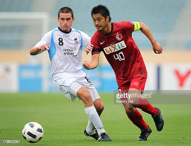 Mitsuo Ogasawara of Kashima Antlers and Stuart Musialik of Sydney FC compete for the ball during the AFC Champions League Group H match between...