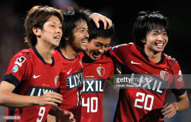 Mitsuo Ogasawara of Kashima Antlers celebrates the first goal with his teammates Yuya Osako Shinzo Koroki and Gaku Shibasaki during the JLeague match...