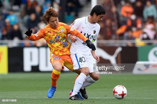 Mitsuo Ogasawara of Kashima Antlers controls the ball under pressure of Shota Kaneko of Shimizu SPulse during the JLeague J1 match between Shimizu...