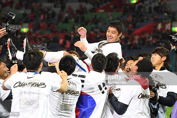 Mitsuo Ogasawara of Kashima Antlers is tossed into the air by players after winning the JLeague Championship Final second leg match between Urawa Red...