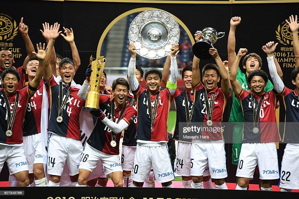 Mitsuo Ogasawara of Kashima Antlers lifts the shield after winning the J.League Championship after the J.League Championship Final second leg match between Urawa Red Diamonds and Kashima Antlers at Saitama Stadium on December 3, 2016 in Saitama, Japan.