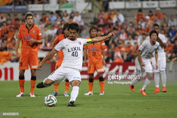 Mitsuo Ogasawara of Kashima Antlers scores hsi team's first goal from the penalty spot during the JLeague match between Shimizu SPulse and Kashima...