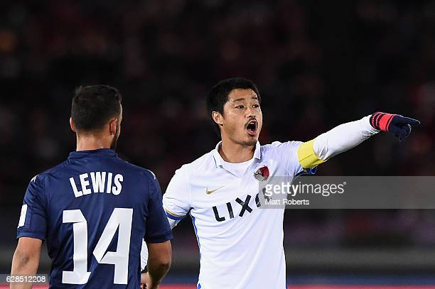 Mitsuo Ogasawara of Kashima Antlers signals to his team mates during the FIFA Club World Cup Playoff for Quarter Final match between Kashima Antlers...
