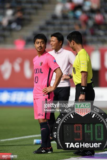 Mitsuo Ogasawara of Kashima Antlers stands on the touchline to be brought in during the JLeague J1 match between Sanfrecce Hiroshima and Kashima...