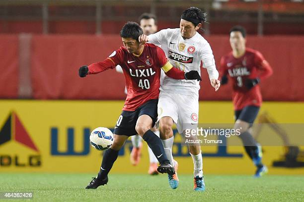 Mitsuo Ogasawara of Kashima Antlers Yojiro Takahagi of Western Sydney Wanderers FC compete for the ball the ball during the AFC Champions League...