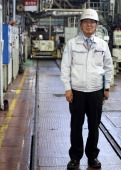 Mitsuru Kawai senior technical executive of Toyota Motor Corp poses for a photograph in the forging department at one of the company's plants in...