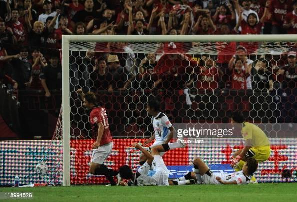 Mitsuru Nagata of Urawa Red Diamonds scores the second goal during the JLeague match between Urawa Red Diamonds and Kawasaki Frontale at Saitama...