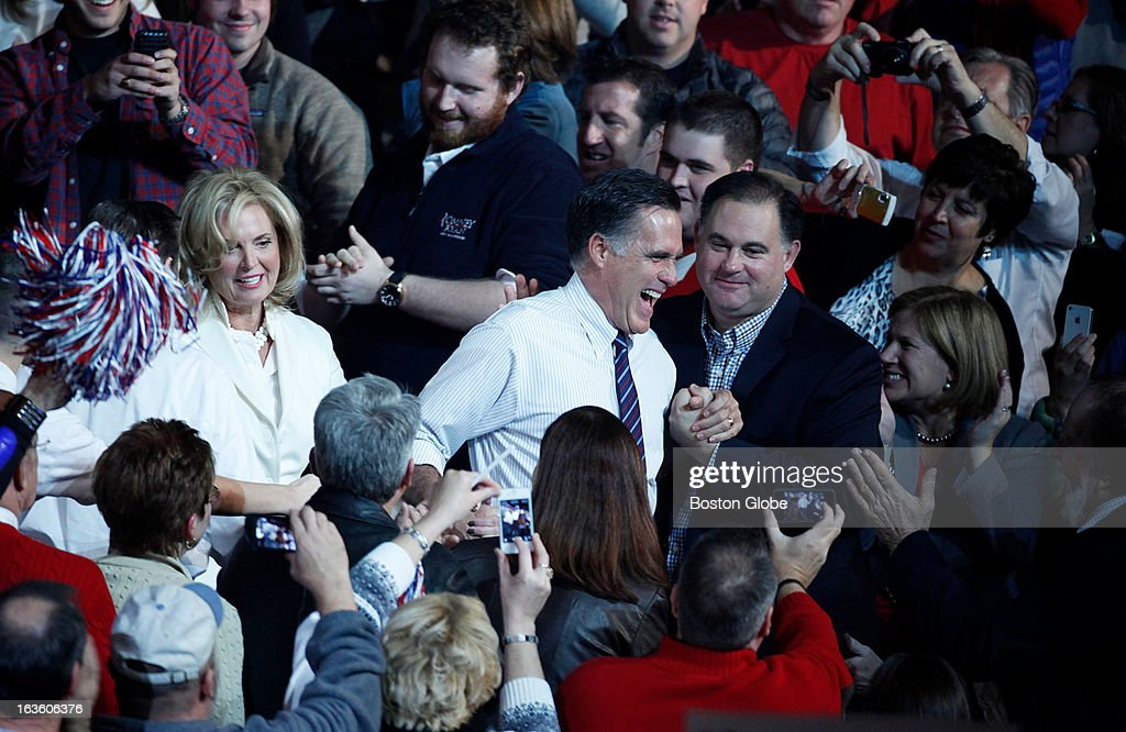 Mitt and Ann Romney make a surprise entrance through the crowd after being introduced by musician Kid Rock. GOP presidential candidate Mitt Romney holds a final victory rally at the Verizon Wireless Arena in Manchester, N.H. on Tuesday, Nov. 6, 2012. Musician Kid Rock performed for the rally.