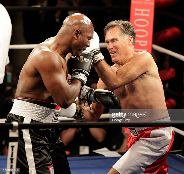 Mitt Romney and Evander Holyfield fight in a charity boxing event on May 15 2015 in Salt Lake City Utah The event was held to raise money for...