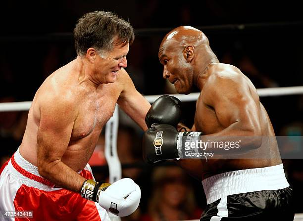 Mitt Romney Evander Holyfield fight in a charity boxing event on May 15 2015 in Salt Lake City Utah The event was held to raise money for 'Charity...