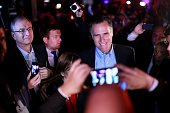 Mitt Romney is greeted by fellow Republicans at a dinner during the Republican National Committee's Annual Winter Meeting aboard the USS Midway on...