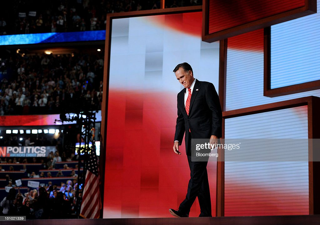 Mitt Romney, Republican presidential candidate, arrives on stage to speak at the Republican National Convention (RNC) in Tampa, Florida, U.S., on Thursday, Aug. 30, 2012. Romney, a wealthy former business executive who served as Massachusetts governor and as a bishop in the Mormon church, is under pressure to show undecided voters more personality and emotion in his convention speech tonight, even as fiscal conservatives in his own party say he must more clearly define his plans for reining in the deficit and improving the economy. Photographer: Daniel Acker/Bloomberg via Getty Images