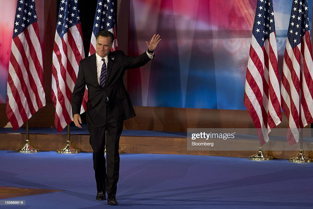 Mitt Romney, Republican presidential candidate, arrives to make a concession speech during his election rally at the Boston Convention and Exhibition Center in Boston, Massachusetts, U.S., in the early morning on Wednesday, Nov. 7, 2012. U.S. President Barack Obama, the post-partisan candidate of hope who became the first black U.S. president, won re-election today by overcoming four years of economic discontent with a mix of political populism and electoral math. Photographer: Andrew Harrer/Bloomberg via Getty Images