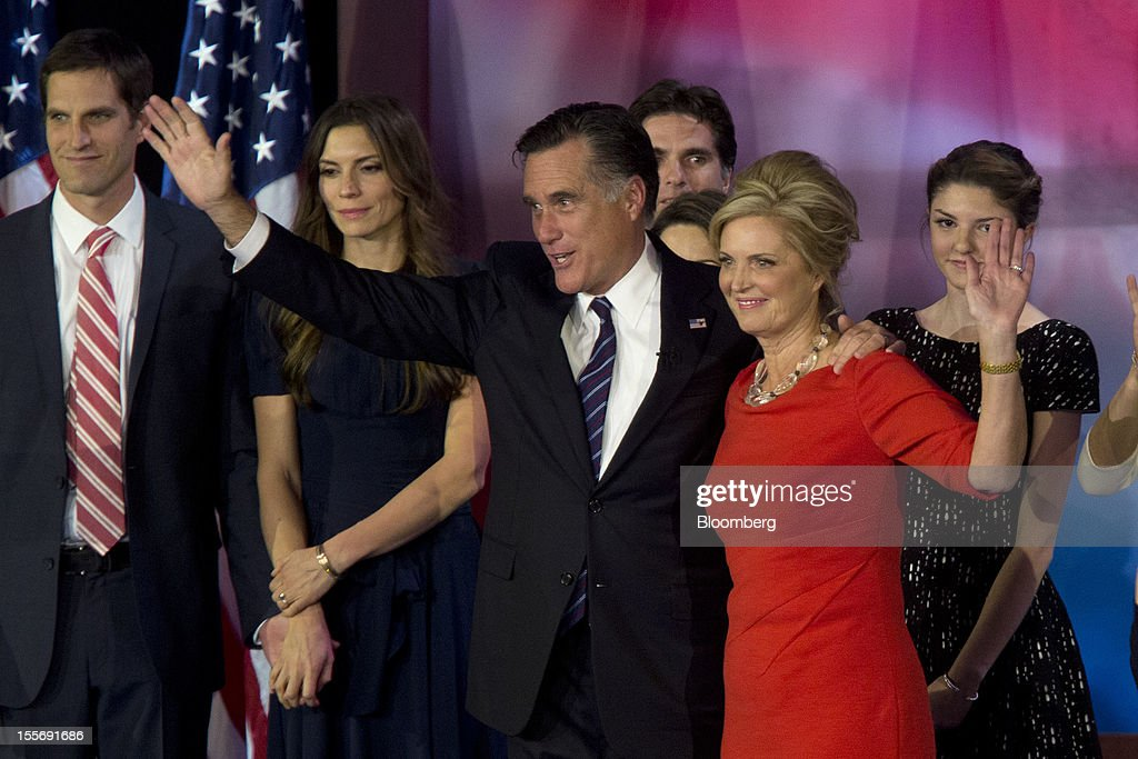 <a gi-track='captionPersonalityLinkClicked' href=/galleries/search?phrase=Mitt+Romney&family=editorial&specificpeople=207106 ng-click='$event.stopPropagation()'>Mitt Romney</a>, Republican presidential candidate, center, and wife <a gi-track='captionPersonalityLinkClicked' href=/galleries/search?phrase=Ann+Romney&family=editorial&specificpeople=868004 ng-click='$event.stopPropagation()'>Ann Romney</a>, second right, wave to the crowd following his concession speech during an election rally at the Boston Convention and Exhibition Center in Boston, Massachusetts, U.S., in the early morning on Wednesday, Nov. 7, 2012. President Barack Obama, the post-partisan candidate of hope who became the first black U.S. president, won re-election today by overcoming four years of economic discontent with a mix of political populism and electoral math. Photographer: Andrew Harrer/Bloomberg via Getty Images
